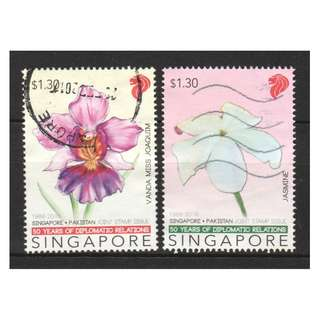 SINGAPORE 2016 PAKISTAN JOINT ISSUE NATIONAL FLOWERS (ORCHID & JASMINE) COMP. SET OF 2 STAMPS IN FINE USED CONDITION