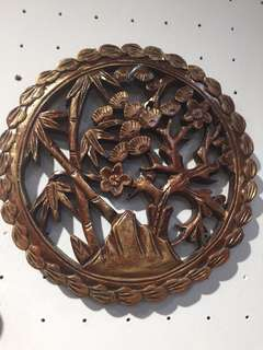 Round wooden wall carving