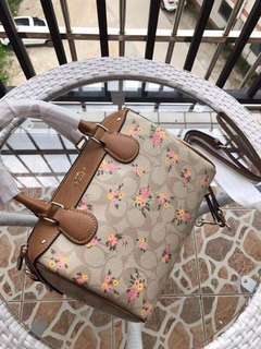Authentic Coach Sling Bag with Flower Design
