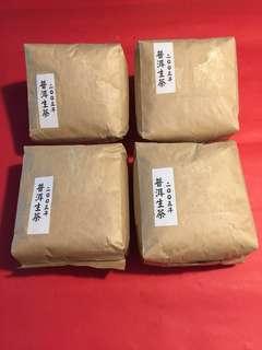 四包普洱生茶:2005 年散茶(4包共重約1200克/2 斤);如相片所示)
