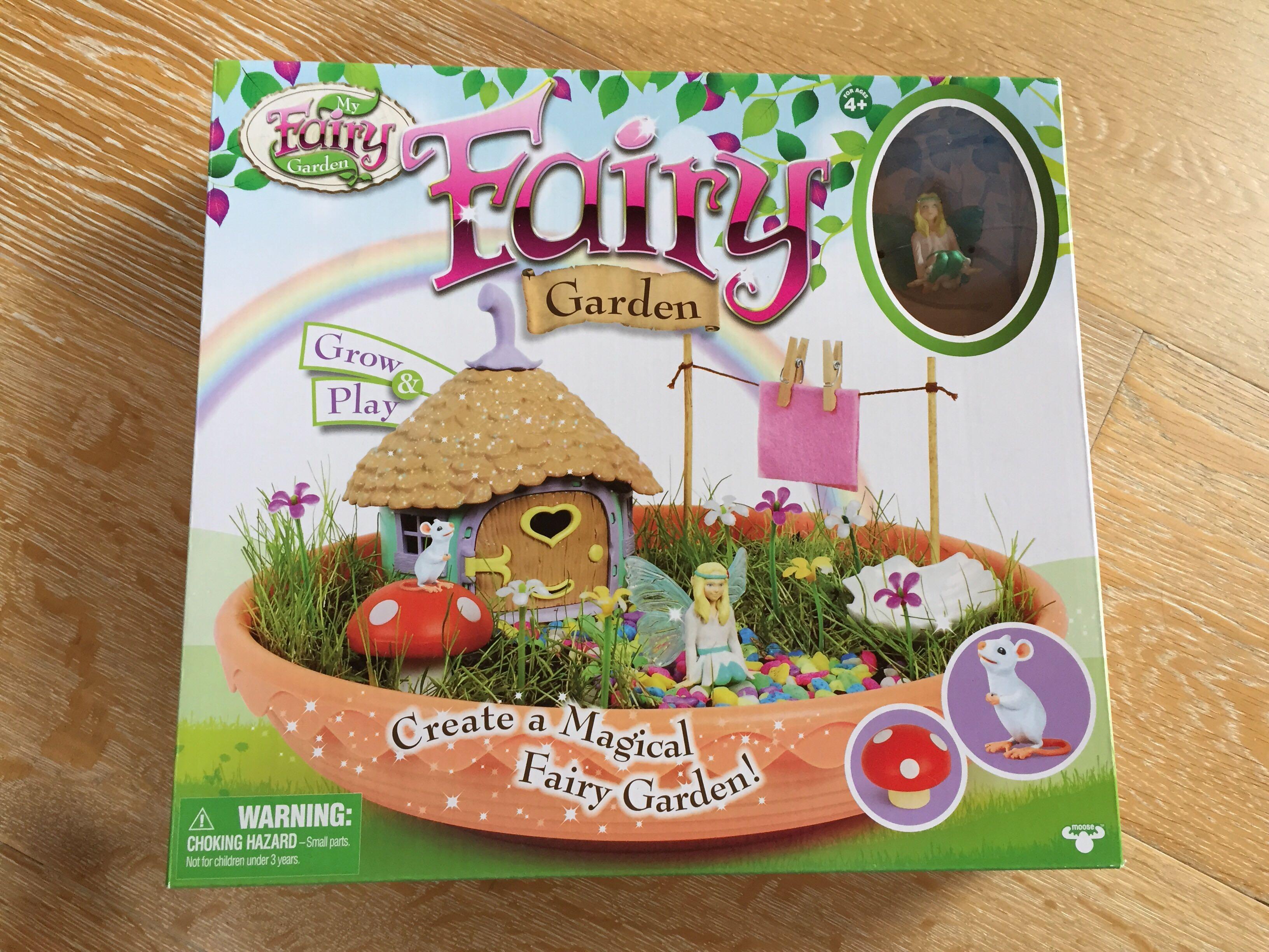 Children create a fairy garden kit