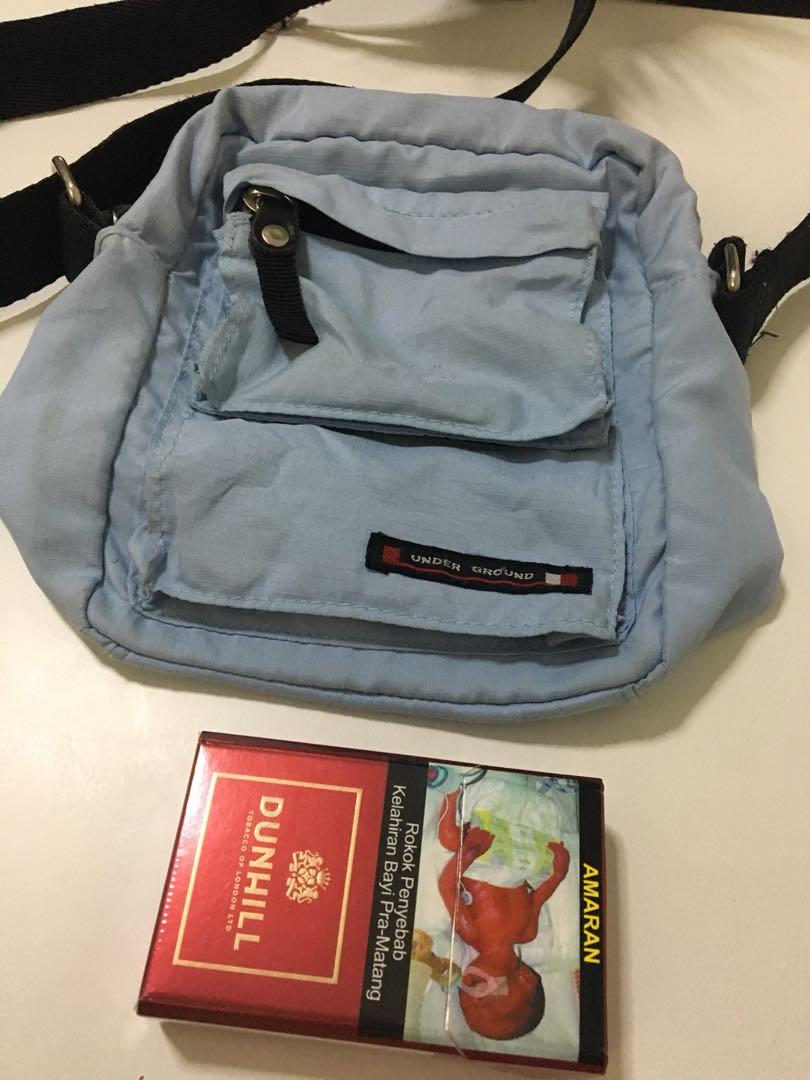 698f2e295d34 Sling bag under ground