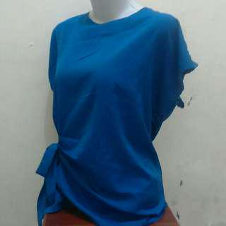 Blouse pita di samping