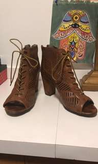 Pair of brown leather heeled boots Size 8