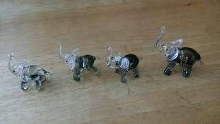 Set of elephant glass figurines