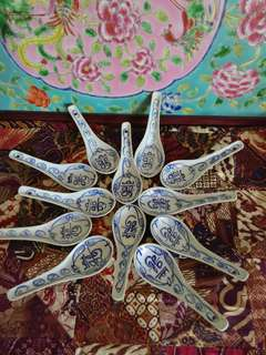 White n blue spoons with the word Xi