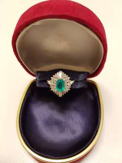 1981 Vintage, Authentic, Genuine and Brand New Platinum Emerald Diamond Ring. Emerald is 0.62ct. Diamond is 0.74ct.