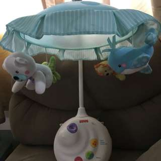 Musical toy crib