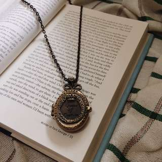 Queen of couture locket necklace