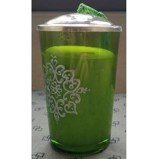 Candle in green glass