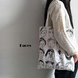 Faces Canvas Tote Bag.
