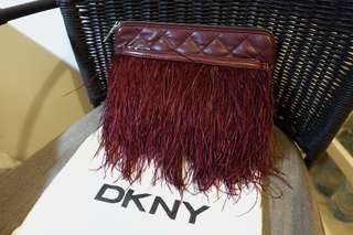 Feather wrap leather clutch in burgundy