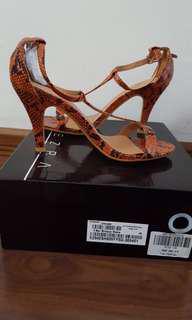 Never used strappy heels in orange snakeskin prints
