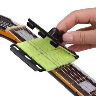 Pembersih senar gitar