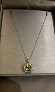 Peoples august birthstone ring and necklace