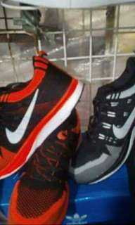 Orange / Black Nike shoes