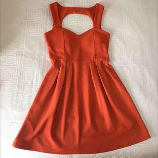 Orange skater dress with sweetheart neckline and cut-out open back