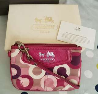 100% Original Coach small wristlet (bought in Macau) used once and comes with a special gift box.