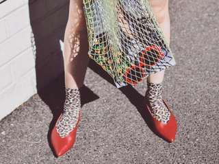 Red pointy sling backs