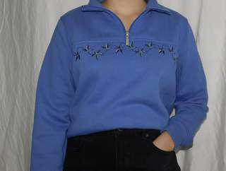 Blue sweater with flower design