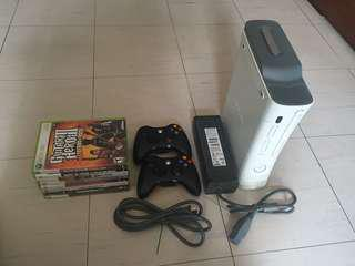 Xbox 360 console with controllers and games