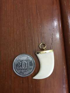 Authentic elephant ivory pendant. Set in gold plated