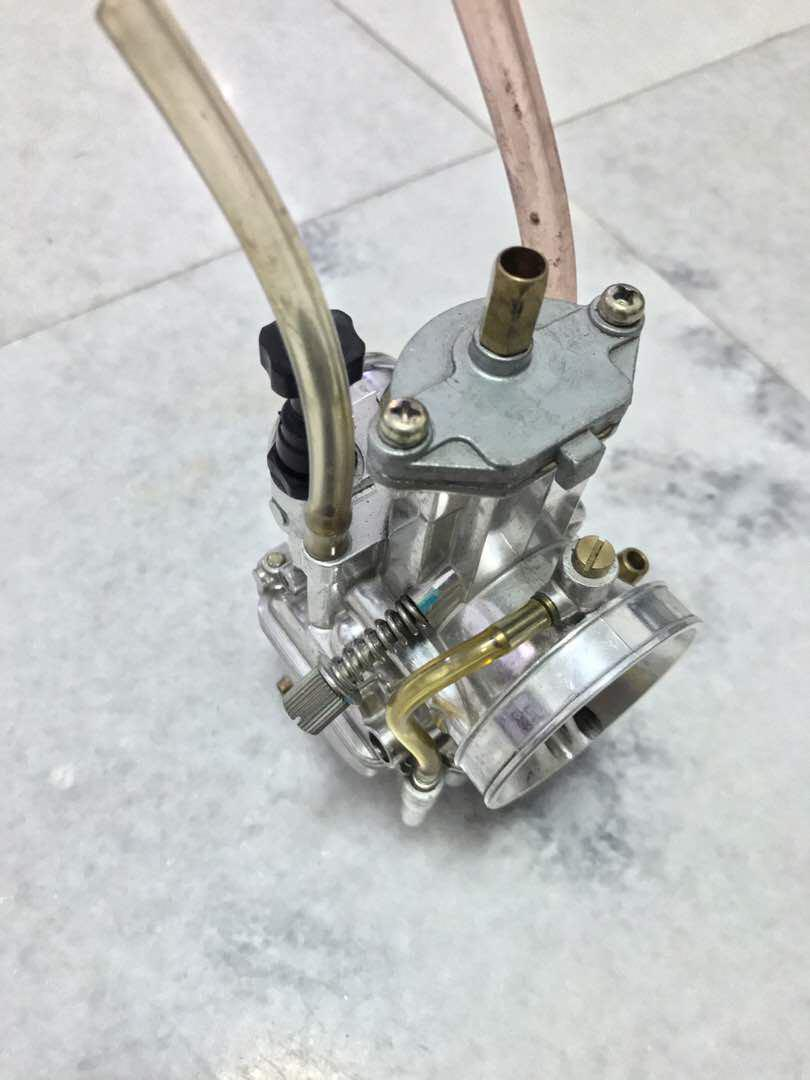 Uma Racing carburettor