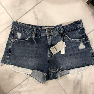 BNWT TOPSHOP RIPPED SHORTS