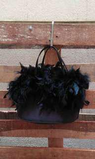 Black evening bag with feathers