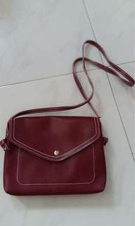 Maroon small envelope sling bag