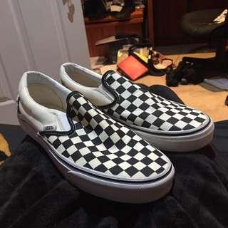 Checkered slip on black and white Vans