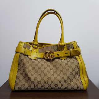 Authentic Gucci handbag bag - monogram with lime green handle and Gucci crest
