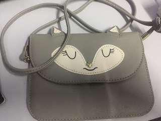 Grey fox sling bag