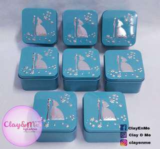 Pastel wedding themed tin cans