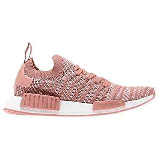 Pink nmd fits like size 7 but actually size 5.5
