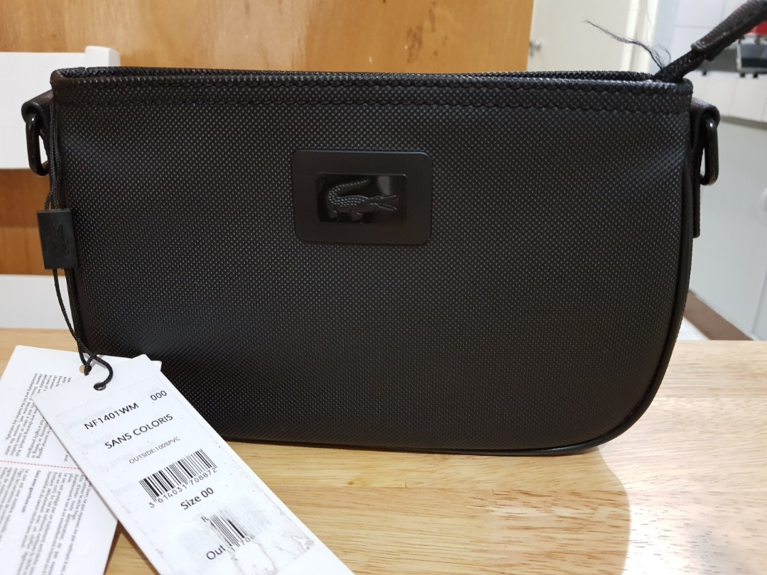 8360e64c8a0e Authentic Lacoste Clutch Bag with Tag