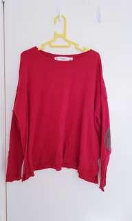 Red jumper with elbow patches