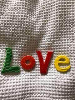 Ceramic love wall art