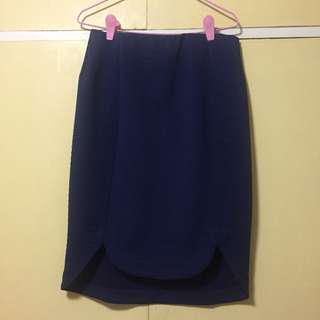 Stretchy blue skirt with scallop front design