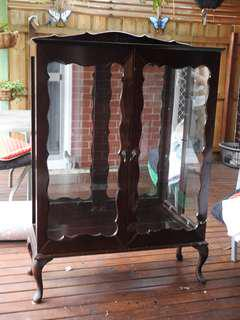 Antique wood/glass cabinet w/ mirror back