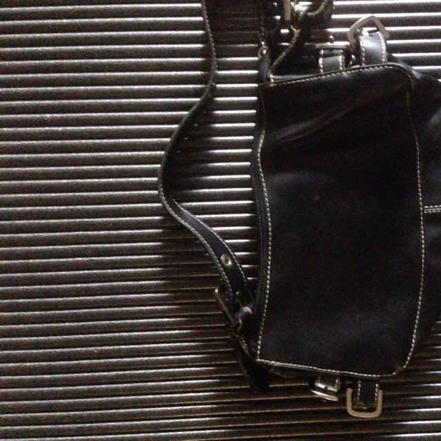 New ladies handbag color black.