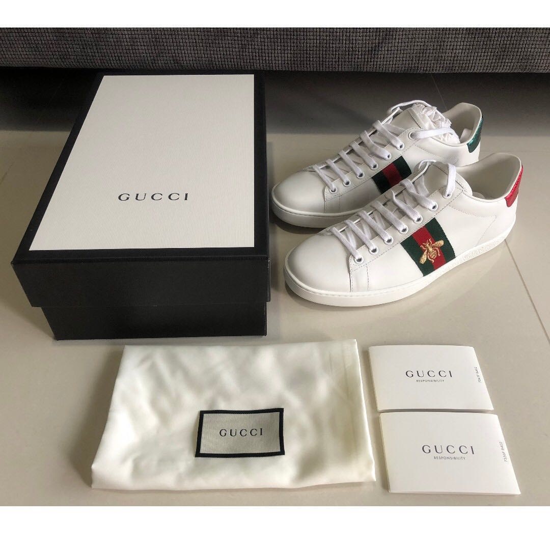 83b0c35b9b5 Women s Gucci Ace Embroidered Leather Sneakers with Gold Embroidered ...