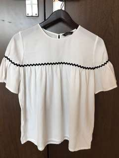 White top with black embellishment