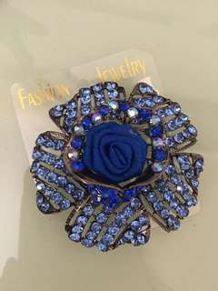 Blue rose brooches