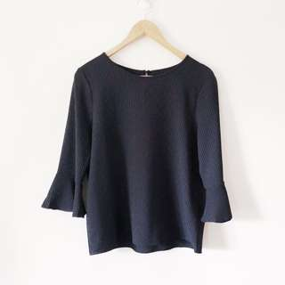 Black Top with Fluted Sleeves