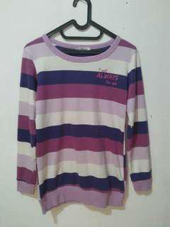 Sweater belang ungu