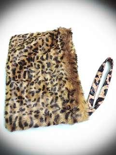 Reduce price leopard print clutch . A4 size