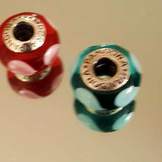 2 Authentic Pandora beads/comes with pandora pouches
