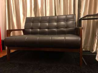 Two seater black vintage couch