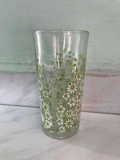 Flowers in white and green glass